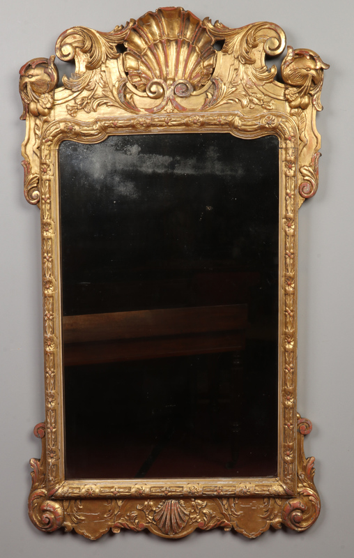 An antique Irish giltwood hall mirror. T