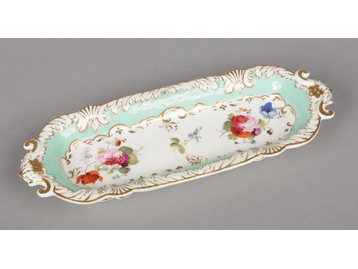 A Rockingham pen tray with C-scroll m...