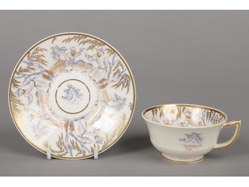 A Rockingham teacup and saucer of fig...