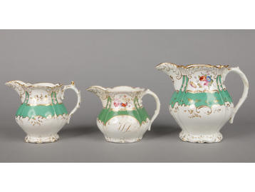 A large Rockingham jug and two smalle...