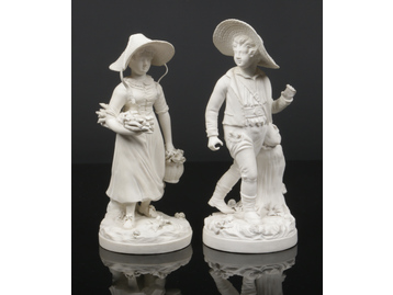 A pair of Rockingham biscuit figures,...