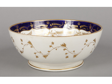 A large Rockingham punch bowl with we...