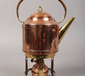 A copper and brass spirit kettle....
