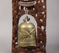 A Chinese bronze prayer bell on carve...