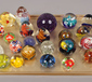 A tray of glass paperweight including...