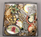 Thirty two costume jewellery brooches...