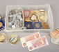 A box of coins and bank notes to incl...