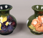 Two Moorcroft green ground baluster v...