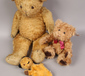 Three teddies to include Sooty hand p...