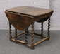 A carved oak drop leaf gateleg table,...