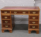 A mahogany pedestal desk with inset r...