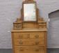 A carved pine dressing table over fou...