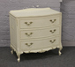 A cream painted bow front chest of th...