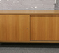 A retro teak effect sideboard with sl...