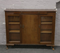 A mahogany display cabinet on cabriol...