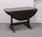 An ebonised drop leaf dining table wi...