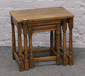 A nest of three oak occasional tables...