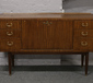 A mahogany sideboard with drop down c...