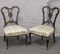 A pair of carved mahogany salon chair...