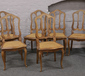 A set of six bergere seat chairs rais...