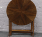 A quarter veneered circular folding o...