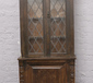 A carved and panelled oak lead glazed...