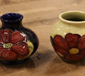 Two Moorcroft squat vases both in The...