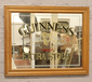 A framed Guinness Extra Stout adverti...