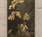 A Chinese black lacquered wooden wall...