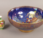 A Carltonware lustre bowl with blue g...