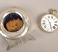 A silver mounted pocket watch holder,...