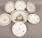 A collection of ceramic plates to inc...