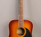 An Encore acoustic guitar model numbe...