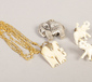 A pair of carved bone elephant earrin...