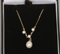 A 9ct gold diamond and pearl necklace...