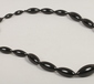 A large black bead graduated necklace...