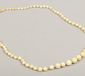 A ivory necklace of graduated beads....