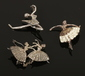 Two silver and marcasite ballerina br...