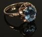 A 9ct gold dress ring set with a blue...