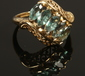 An 18ct gold ring, diagonally set wit...