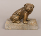 A brass figure of a pug dog raised on...