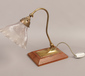 A vintage swan neck desk lamp with br...