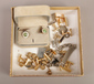 A box of assorted gold plated cufflin...