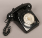 A black vintage Rotary dial telephone...