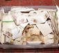 A box of pottery cheese dishes variou...