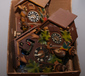 A box of vintage cuckoo clocks for sp...
