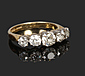An 18 carat gold five stone diamond ring