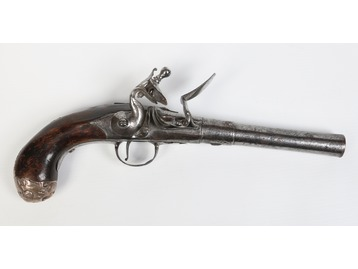A Queen Anne flintlock pistol.
