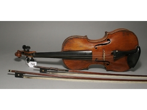 A violin and two bows.