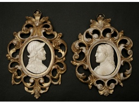 Two carved ivory portraits.